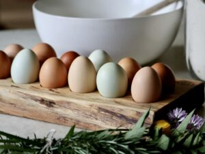 Wooden Egg Tray holding farm fresh eggs