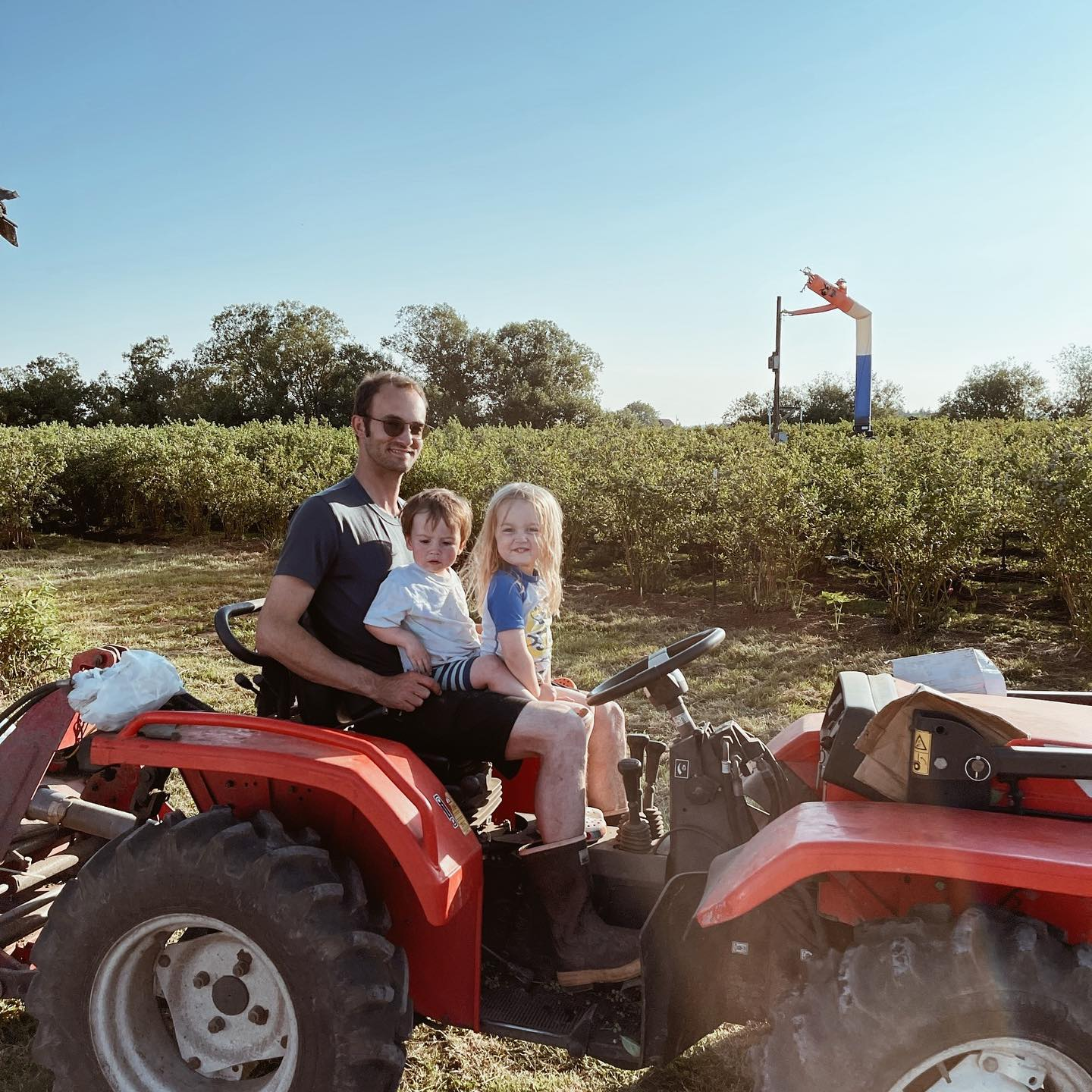 Bow Hill Blueberries owner Ezra Ranz on tractor